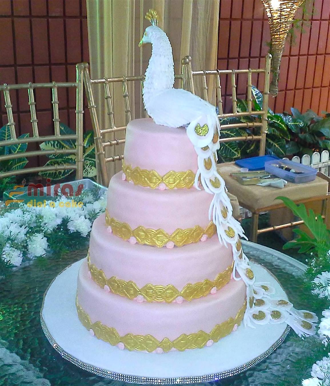 Peacock Wedding Cake.4 Tier White Peacock Wedding Cake 10 Kg